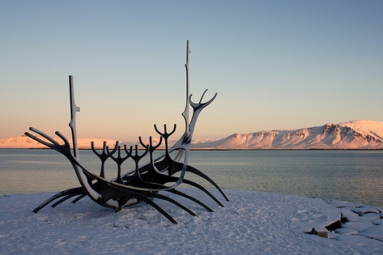 Sculpture of Viking ship against sea