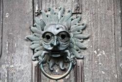 Lionesque-faced door knocker