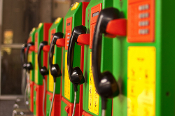 Colourful telephones boxes in a line